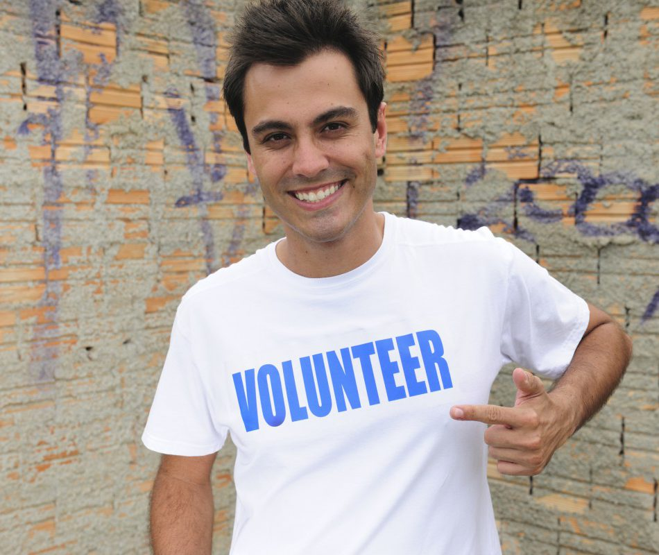 Man wearing volunteer t-shirt